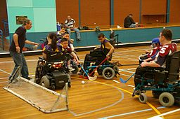 Children in electric wheelchairs playing power hockey
